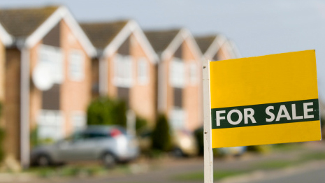 Residential and National Sales: Houses with For Sale sign in front